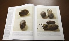 Pictures of a smooth, brown, egg-sized rock are shown in the printer's manuscript of the Book of Mormon following a news conference at the Church of Jesus Christ of Latter-day Saints Church History Library, in Salt Lake City.