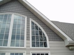 This is an example of Certainteeds Cement board siding in use on one of our custom lake homes. The home owner choose two shades of grey and to use the 'cedar shingle look' in the gable ends. However it is all low maintenance cement siding.
