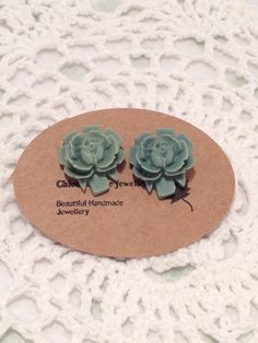 A personal favourite from my Etsy shop https://www.etsy.com/au/listing/505802417/stud-earrings-teal-rose-cameo-large