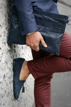 Mens street style fashion: burgundy pants jeans, blue suede loafer shoes, navy blue blazersuit jacket, blue leather balenciaga case bag