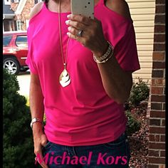 Michael Kors Cold shoulder top MK cold shoulder top. Brown chain link shoulder straps. Radiant Pink. 94% polyester, 6% spandex. Brand new with tags Michael Kors Tops Blouses