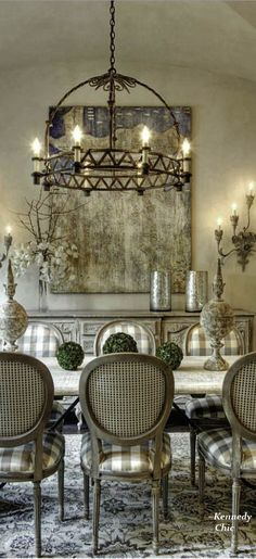 Rustic elegant dining room - taupe/white buffalo check upholstery adds flair to charming muted palette.