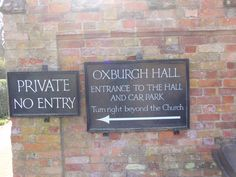 IRS The National Trust signage for Oxburgh Hall.