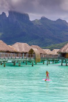 Stand up paddle boarding at the Four Seasons Bora Bora, Tahiti. Take your kids everywhere! Would be a dream trip for us!!