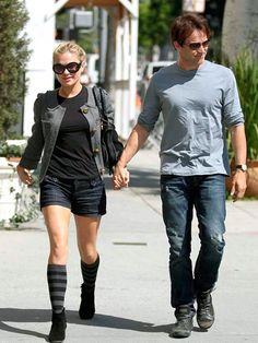 Real-life True Blood sweethearts Anna Paquin and husband Stephen Moyer stay in touch while strolling through Los Angeles Monday.