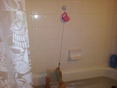 This ingenious technique for safeguarding books from falling in the bathtub was invented by redditor Crash-From-Space's 8-year-old daughter. The suction cup came from the plumbing aisle at Home Despot.