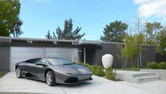 I'd replace the lambo with a ferrari and i wish it had more original garage doors, but over all nice :)