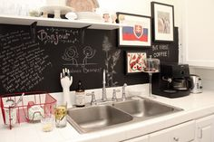 Ok, I will never get on board with the chalkboard trend, but this is a really adorably styled kitchen. Love the red dish rack and the cake stand.
