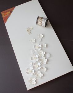 Paper Flowers. Glue on Canvas. Make Small Cuts Behind Flowers. Put Lights Behind.