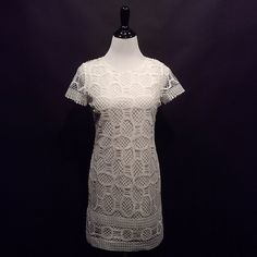 """Gorgeous white lace dress Absolutely love this dress.  NWOT bought as a 4 but it is actually an XXS on label.  Fits like a 2 bust line measures 34"""" length from shoulder to hem is 33"""".  Full cotton lining, lace has a nice hand, not flimsy.  Asking just what I paid for the price of the dress.  Great with a pair of sandals  for casual, or heals for evening, perfect summer go to dress MNG Collection Dresses Mini"""