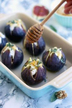 Baked Figs with Goat Cheese: For an extra touch of flavor, sprinkle walnuts, sage, and honey on top of the figs.