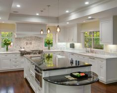 Consider putting a different colored countertop on the center island so that it stands apart from the rest of the kitchen