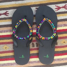 Sanuk Flip Flops If you have ever worn Sanuk's you know they are truly the most comfy sandals ever made! Awesome beaded detailing, never worn. Size 10-11 Sanuk Shoes Sandals