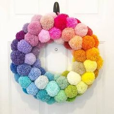 It's finally done! Here's the yarn pompom wreath I've been working on FOREVER! It took 5 stores, 50 Pom Pom Crafts, Yarn Crafts, Craft Projects, Crafts For Kids, Preschool Crafts, Craft Ideas, Arts And Crafts For Adults, Arts And Crafts House, Pom Pom Wreath