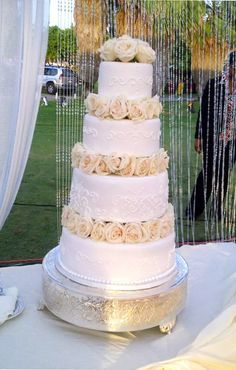 Wedding Cakes: Four tier wedding cake with white flowers