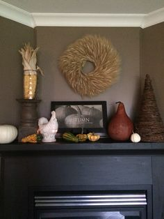Our autumn mantle decorated with pumpkins, gourds and a little bit of wheat