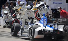Takuma Sato's crew jumps out to service his car on a pit stop. (Scott Varley, PRESS-TELEGRAM)