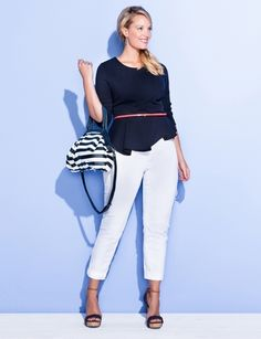 Peplum with an edge, paired with white jeans. Spring all over it