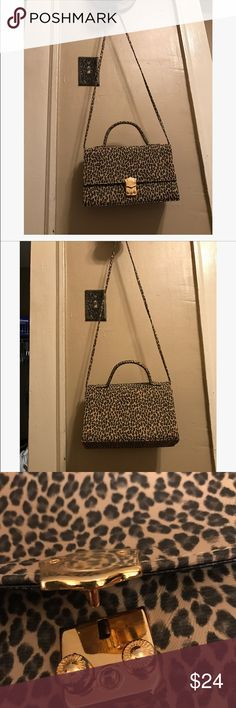 """Like New Vintage Cheetah Crossbody Excellent condition/ no flaws whatsoever! Strap can be removed so that you can carry it by the handle if you wished. Third photo shows closure style. Made by """"Objections."""" Vintage Bags Crossbody Bags"""