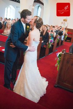 Bride and Grooms first kiss in a white washed church www.grahamcrichton.com