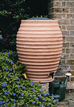 Italianate water butt - styled to look like a large terracotta urn, this water butt is made from plastic and is both durable and lightweight