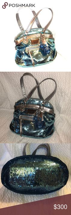 "100% Authentic ""Coach Poppy"" Baby Blue sequined In pristine, beautiful like new condition! PLEASE REMEMBER TO FOLLOW ME AND SHARE SOME OF MY LISTINGS! I will always to the same for you in return and I'm a SHOPAHOLIC so you can be pretty sure I will most likely by something from you in the future!! HAPPY POSHING, my posh sister!!💕😘😘 Coach Bags Satchels"