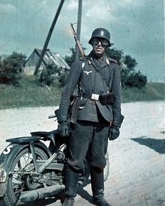 Luftwaffe FD soldat stands next to his DKW NZ250 Krad and note the early all leather motorcyclist gloves - pin by Paolo Marzioli