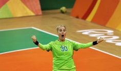 Romania's goalkeeper Paula Ungureanu reacts after making a save during the…