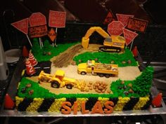 Construction Cake This was for my son's 2nd b'day. Obviously, he's into trucks, tractors, and dirt! Gumpaste signs and name...