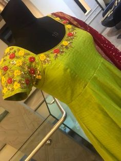 Stunning parrot green color floor length anarkali dress with maroon color bandini dupatta. Anarkali dress with floret lata design hand embroidery work on neckline. 28 May 2018 Simple Gown Design, Long Dress Design, Kurti Embroidery Design, Embroidery Dress, Hand Embroidery, Embroidery Neck Designs, Anarkali Frock, Long Gown Dress, Long Dresses