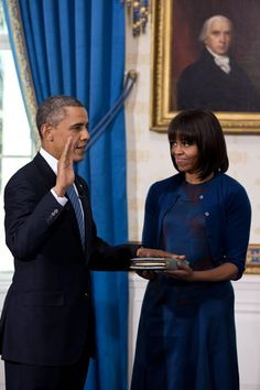 President Barack Obama taking the Oath of Office while the First Lady holds the Bible. Mr. Obama's hand rests on a Bible that Mrs. Obama's father, Fraser Robinson III, had given to his mother, LaVaughn Delores Robinson. Jan 20, 2013.