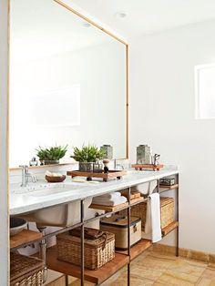 Love the minimalist shelves and huge mirror in this bathroom | #interiordesign #minimalist | via @bhg