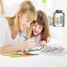 Young Girl coloring with her mother with Crayola Colored Pencils Home Learning, Learning Activities, Resorts In Georgia, Crayola Colored Pencils, Bluff City, Identity Protection, Simple Sentences, Stress Disorders, A Dime