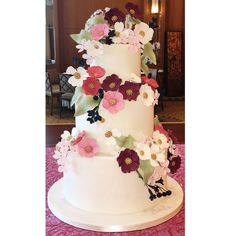Anemones, blossoms, and berries make this 3 tier a stunning and unique cake!
