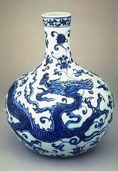 Flask;  Porcelain decorated in under glaze cobalt blue;  Ming Dynasty;  early 15th Century;  Influenced by courtly flower painting
