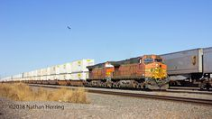 https://flic.kr/p/EqezDX | BNSF 4605 West | A westbound Denver to Los Angeles baretable rolls through the South Yard on its westbound trip to California. (All the containers on this train are empty and being relocated to LA).
