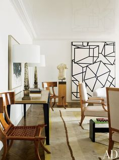In the living room of a New York apartment by Delphine Krakoff the painting at right is Phoenicia VIII by Al Held. | Living Rooms