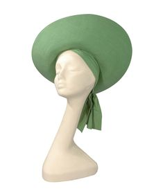 Lilly Dache apple green sun hat | United States, 1938 | Linen, narrow channel stitched almond crown and assymetrical upcurved oval brim, two side panels crossing at rear neck with hook and eye closure, interior circumference 21 inches