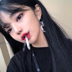 Asian teen girls smoking