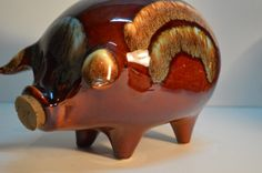 Hull Pottery Piggy bank Hull pottery pig by Austinmodernvintage, $38.00  I actually own this, but mine is missing it's cork : (
