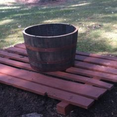 pallet made of barn wood and stained to cover septic lid