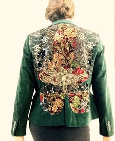 Classic Velvet Jacket reworked on a unique romantic shabby chic textiles mixed with antique and contemporary laces and vintage trims. This Vintage velvet jacket is fully lined , two pockets at the front and one button closure , beautiful deep green . This jacket brings a versatile style as you see at the pictures , the front is solid and apparently doesnt show any handmade embroidered but once you turn back youll be very surprise , a contemporary burlesque style ! Please check the…