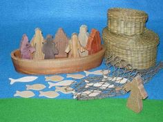 Simple wooden figures and props to play out Bible stories for children.