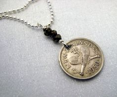 Coin Jewelry - Vintage 1950 NEW ZEALAND 3 pence coin necklace. Silver bail and pyrite beads - crossed Patu. $14.95, via Etsy.