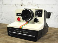 """Polaroid camera!  : ) My parents had this - I loved watching the photo """"develop"""" before our eyes!"""