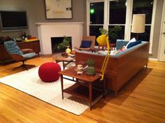Mad Men Modern is a great place for our Carpenter Lamp and Pouf Ottoman.  Thanks Emily Henderson.