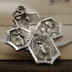 Vintage Sterling Silver Catholic Cross. Total weight 2.0 grams. Approx .75 of an inch wide. Thanks for looking. Questions are always welcomed