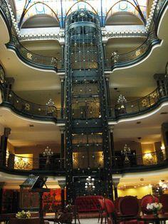 Hotel Ciudad de Mexico — hotel atrium with elevator and balconies. In the Old Portal de Mercaderes,Mexico City