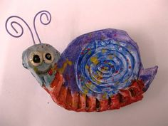 2nd Graders got their hands dirty with clay during this fun project! Students created their snail bodies out of clay slabs, added coils for snail shells and clay spheres for snail eyes! After the clay was fired in the kiln, students added wire antennas, and splatter paint designs to their adorable clay snails!