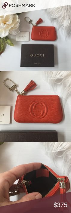 Gucci Key chain Coin Purse Absolutely stunning Gucci Keychain Coin Purse. Beautiful dark orange pebbles leather with gg monogram logo embossed and stitched into the center front. Zipper has a decorative tassel. Hardware is gold. This is brand new, never used, comes with Gucci box and tissue paper. Also comes with authenticity pamphlet. Gucci Accessories Key & Card Holders